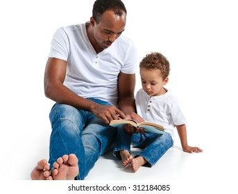 Father and son reading a book. Careful dad helping child to learn new things / photos of Hispanic man and mixed race boy over white background