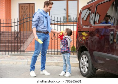 Father and son ready to clean car outdoors