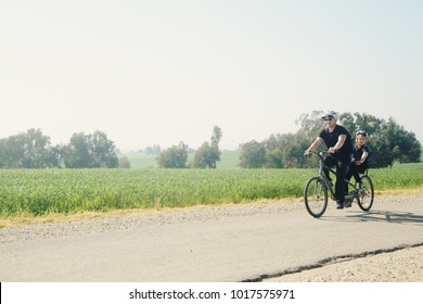father and son ride a tandem bike