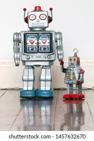 father and son robot toys on wooden floor