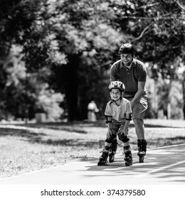 Father and son roller skating together