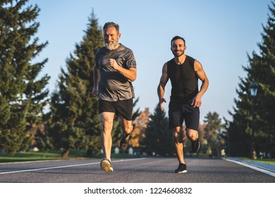 The father and a son running on the park road
