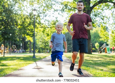 Father and son running together in the park