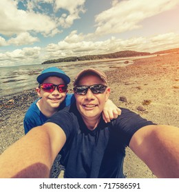 Father and son selfie at the beach in Instagram style