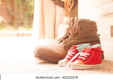Father and son - shoes lined up at doorway