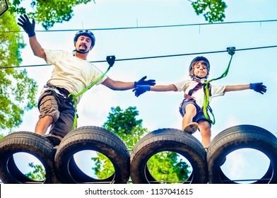 Father and son spend family leisure in the park at the attractions. Healthy lifestyle