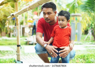 Father and son spend time together on holidays, take care of their love and care for the concept of love and development of their son blur photo not focus.