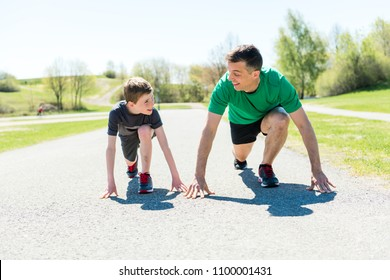father with son sport running together outside