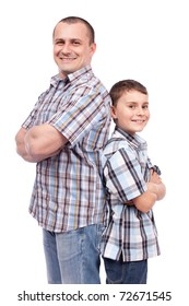 Father and son standing back to back, isolated on white background