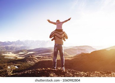 Father and son stands against mountains sunset and having fun. Fathers day concept