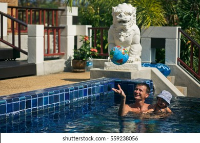 The father with son swim in pool