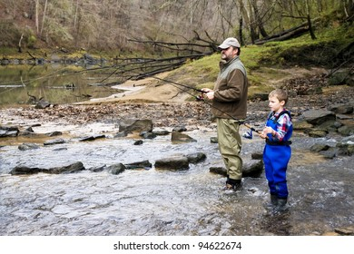 Father and son together catching trout in the river