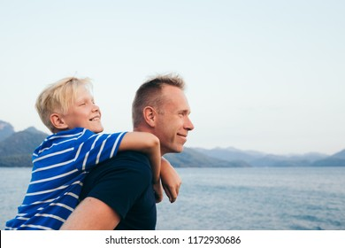 Father and son together. Son hugging father. Summer vacation. Selective focus.