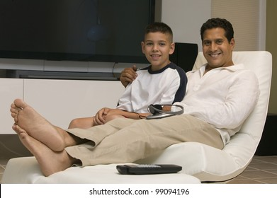 Father and Son Together in Living Room