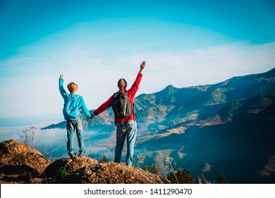 father and son travel in nature, family hiking in mountains