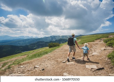 Father and son traveling in Rila mountains Bulgaria