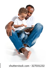 Father and son using tablet computer. Learning and early education concept / photos of Hispanic man and mixed race boy over white background