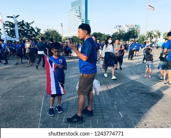 Father and son  are waiting for the AFF Suzuki cup 2018 at Rajamangala National stadium, Bangkok.