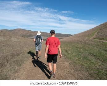 Father and son walking, Chumash and Mugu Peak trail, Point Mugu State Park, Ventura County, California, USA