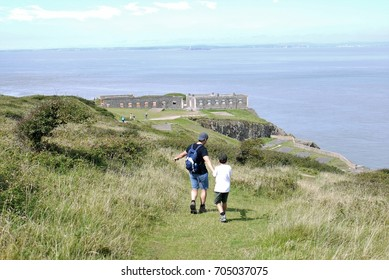 Father and son walking down the natural Pier of Brean Down somerset