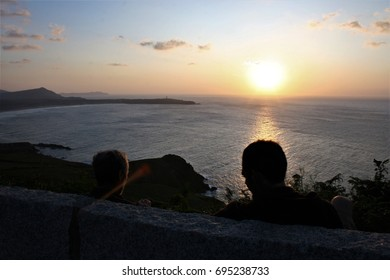 Father and son watching the sunset, peace, calm, serenity, harmony, fullness, well-being, nature, natural, contemplate, meditate, breathe, grow, happiness, tranquility, plenitude, integration, relax
