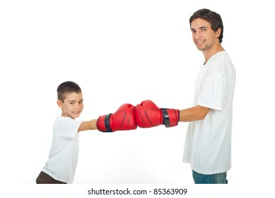 Father and son in white t-shirts having competition with red boxing gloves isolated on white background