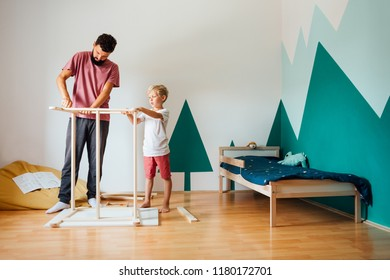 Father And Son Working On Carpentry At Home in Kid's Room