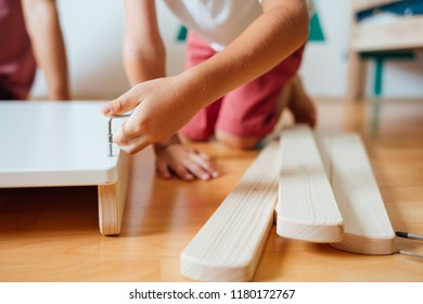 Father And Son Working On Carpentry At Home in Kid's Room, Closeup