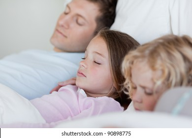 Father taking a nap together with his children