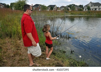 a father teaches his daughter to fish
