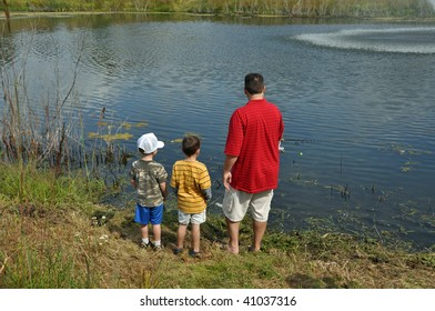 a father teaches his sons to fish