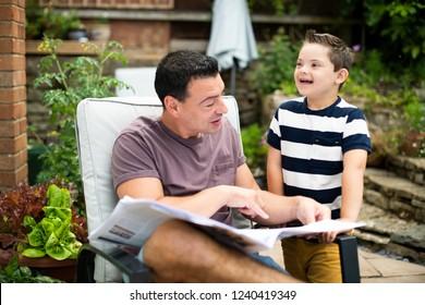 Father teaching his cute son