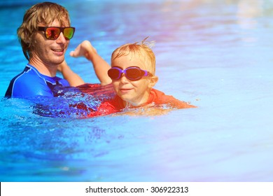 Father teaching his little son to swim, kids sport