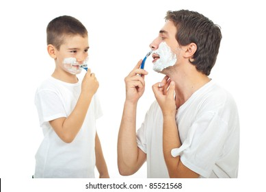 Father teaching his son to shave isolated on white background