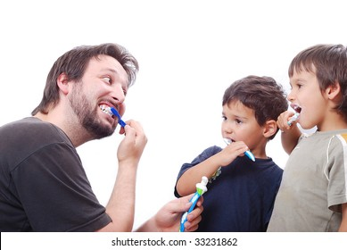 Father is teaching his sons hot to clean the teeth properly