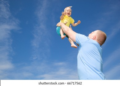 Father throwing his daughter in the air
