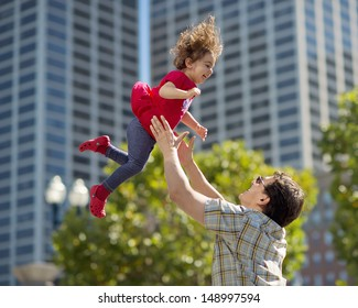 Father Tossing Daughter up in the Air
