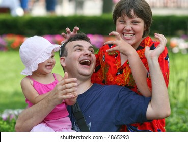 Father and two happy children