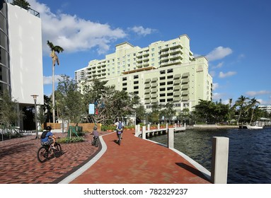 Father and two sons riding bikes and enjoying beautiful Fort Lauderdale Riverwalk.