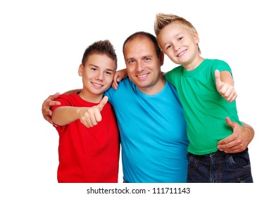 Father with two sons showing thumbs up