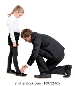 Father tying daughter's shoelaces on a white background