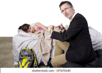 father waking up lazy daughter for school