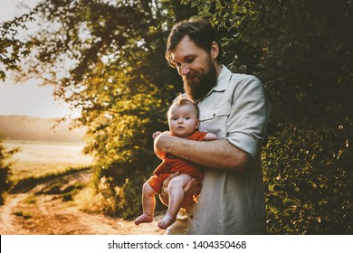 Father walking with baby daughter family lifestyle outdoor dad and child traveling together parenthood love emotions concept Fathers day