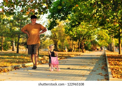 father walking with his baby girl in the park