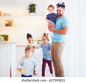 father with weird hairstyle looking after mad kids at home
