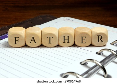FATHER word written on wood block