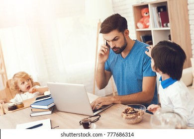 The father works at home and is engaged in the upbringing of sons. A man works and looks after the children.