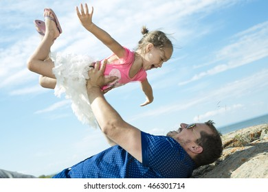 Father with young daughter having fun outside