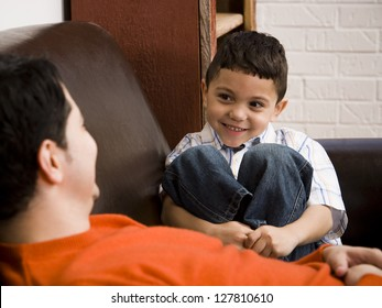 Father and young son talking