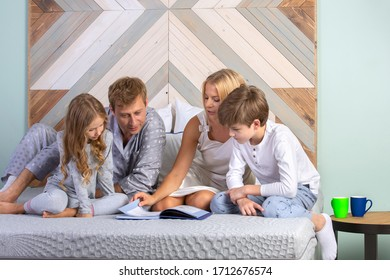 Father,mother, son and daughter in bedroom